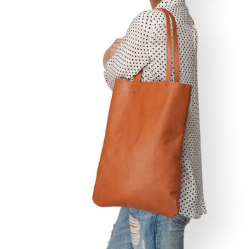 Brown leather tote bag by Leah Lerner