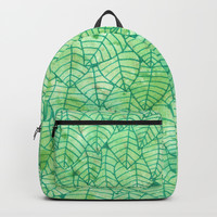 Green foliage Backpacks by Savousepate