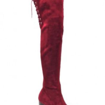 This beautiful thigh high boot features a faux suede upper, almond toe, corset lace up upper back with drawstring straps, and black faux wooded stack heel, and lug. Finished with cushioned insole and inner side zipper closure for easy on/off.