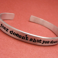 Divergent Inspired - fear doesn't shut you down; it wakes you up - A Hand Stamped Aluminum Bracelet