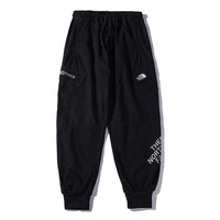 The North Face New fashion reflective letter print couple pants  Black