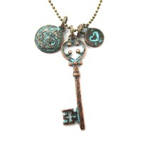 Antique Skeleton Key Heart and Crest Shaped Charm Necklace in Brass | DOTOLY