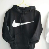 NIKE autumn and winter models men and women loose sports hooded sweater