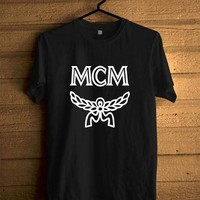 mcm-supreme-obey-logo-printed-unisex-tshirt-black-and-white-tee-m-1 number 1