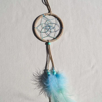 Multicolor dreamcatcher/ Beige suede/ Hand dyed feathers/ Rainbow Blue-Green web