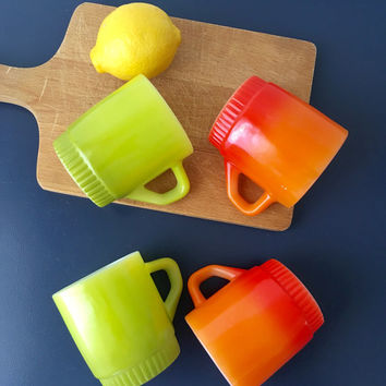 vintage Fire King mugs orange and chartreuse citrus colored stacking mugs