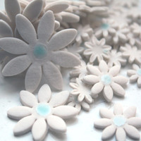 White daises from Royal stoneware porcelain in 4 sizes with a touch of blue celadon glaze - a mix of 50