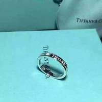 Tiffany & Co. Super Classic three drilling English logo ring couples to ring