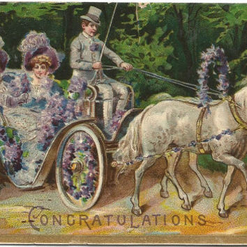 Horse Drawn Carriage with two beautiful ladies and a dapper driver Vintage Postcard