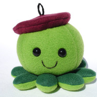 Plush artist octopus toy with burgundy beret hat