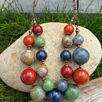 Earthy ceramic and copper metal necklace.