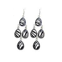 "zebra/tiger teardrop chandelier earrings at Joji Boutique: Tiers of gorgeous 0.75"" faceted teardops with a tiger/zebra pattern hang 2.75"" from the hook. #jewelry #joji #fashion #gifts"