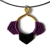 golden wire pendant with micro macrame elements in purple and black on black steel necklace, macrame fashion jewelry with aluminium wire