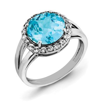 Light Blue And White Topaz Halo Ring in Sterling Silver
