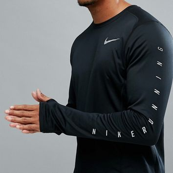 Nike Running Flash Miler Reflective Long Sleeve Top In Black 858153-010 at asos.com