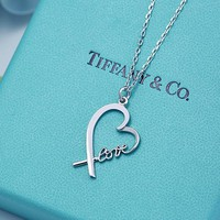 Tiffany & Co. Love cross hollowed out love necklace