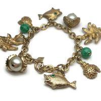 Vintage Sarah Coventry Gold Tone Beach Charm Bracelet - Fish Water Lily Crab Claw Seashell Oyster Shells w/ Faux Pearl Charms Green Beads