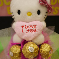 Hello Kitty doll bouquet with 3 Ferrero Rocher chocolates. Cute Valentine's day gift!