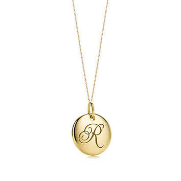 Tiffany & Co. - Tiffany Notes alphabet disc charm in 18k gold, small. Letters A-Z available.