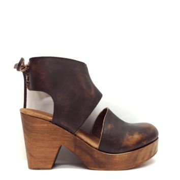 Closed toe leather clogs with lace-up detailing in the back. Wooden heel. Features Spanish craftsmanship.
