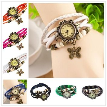 Perfect for bracelet lovers, this leather watch features a dangling butterfly charm and multiple bands.