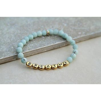 Breathe Gemstone Stretch Bracelet in Blue Ammonite with Gold Lettering