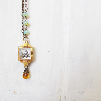 Beekeeper shadowbox necklace, silver honey bee,10k rgp repurposed vintage watch case, baby blue opal czech glass, amber drop, locket jewelry