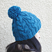 Knit hat  for women in dark blue colors with cables and pompom