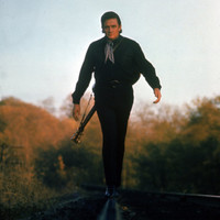 Country Music Star Johnny Cash Walking Along Line of Railway Track with His Guitar Premium Photographic Print by Michael Rougier at AllPosters.com