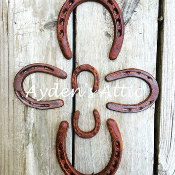 Rusted & sealed cast iron horseshoe set. Country craft supplies. Horseshoe decor. Rustic home decor. Gift of luck. Housewarming gift. Rusty