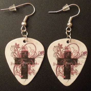 Cross with light pink design guitar pick earrings by featherpick