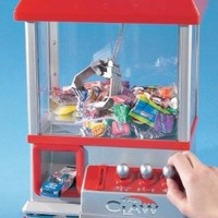 """The Claw"" Electronic Candy Grabber Machine Arcade Game:Amazon:Toys & Games"
