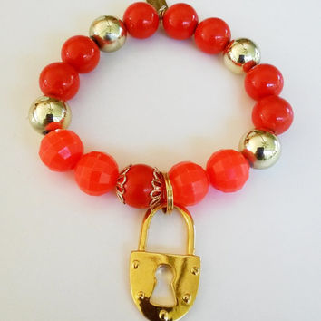Upcycled Bright Orange Gold Tone Lock Charm Elastic Stacking Bracelet