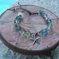 Seaglass bead crochet bracelet blue green white with silver starfish with vintage button clasp tassel