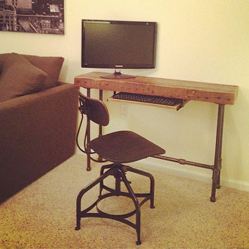 Small desk for laptop made of reclaimed wood and steel pipe legs
