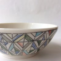 Wheel thrown small porcelain bowl, decorated with a mishima geometric diamond pattern, and soft underglazes