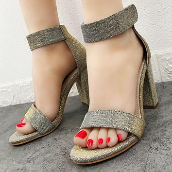 Fashionable women's sandals with magic tape and bright sequins with thick high heels