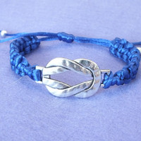 Rat tail cord bracelet with knots and a big knot metal bead  in royal blue colour.