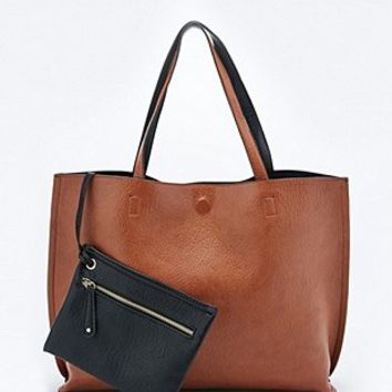 Reversible Vegan Leather Oversized Tote Bag in Tan and Black - Urban Outfitters