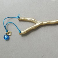 Gold slingshot sculpture, life size brass slingshot with turquoise cord, blue eye and horseshoe charms, goodluck slingshot art object gift