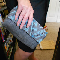 gray and blue hand bag