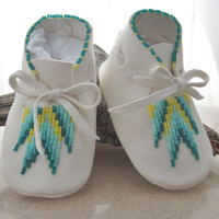 Soft beaded baby moccasins made of supple deer hide, suitable for boys and girls......the sole measures 4.25 inches from heel to toe.