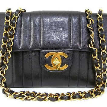 Vintage CHANEL black classic 2.55 jumbo caviar leather, large chain, large shoulder bag with golden CC. Vertical stitch.