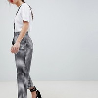 ASOS DESIGN Petite tailored gingham tapered PANTS with belt and buckle detail at asos.com