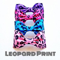 Set of 4- Leopard print handmade fabric hair bow from Bowlicious Divas Bowtique