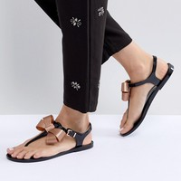 Ted Baker Camaril Black T-Bar Bow Flat Sandals at asos.com