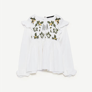 SHIRT WITH EMBROIDERED FLOWER DETAILS