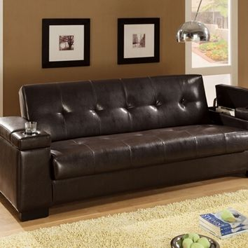Dark brown colored leather like vinyl upholstered folding sofa bed with tufted back and seat with cup holders in arms