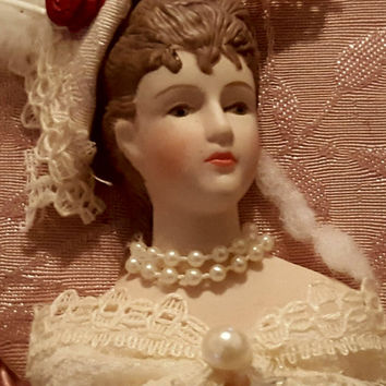 Porcelain Victorian Doll Face Wall Hanging Decor Surrounded by a Embroidered Heart Shaped