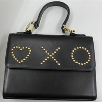 Vintage MOSCHINO black leather handbag in classic kelly purse style with golden studded heart, X, and O, playful motifs. Perfect daily bag